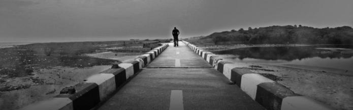 the lonely walk by Vinoth Chandar on flickr 960x300 75pc